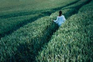 woman-walking-grass-field